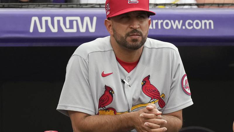 FILE - St. Louis Cardinals bench coach Oliver Marmol watches from the dugout in the first...