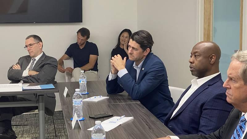 Sen. Tim Scott and former House Speaker Paul Ryan hear from businesses inside of the Charleston...