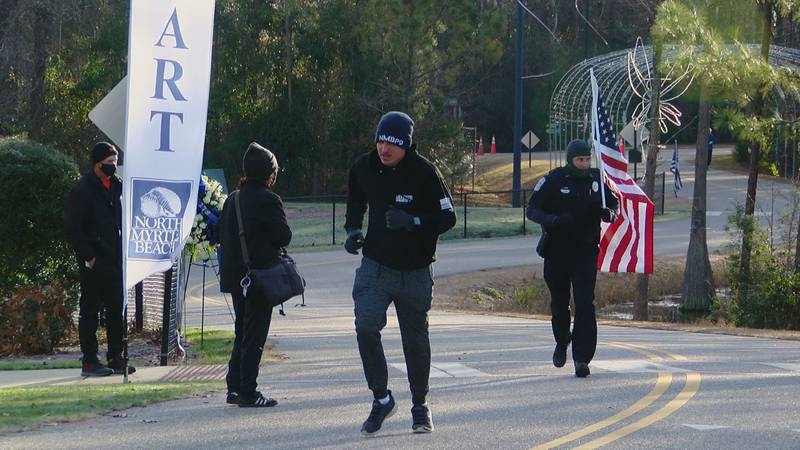 Police Chief Tommy Dennis carried an American flag throughout the 1.78 mile race.