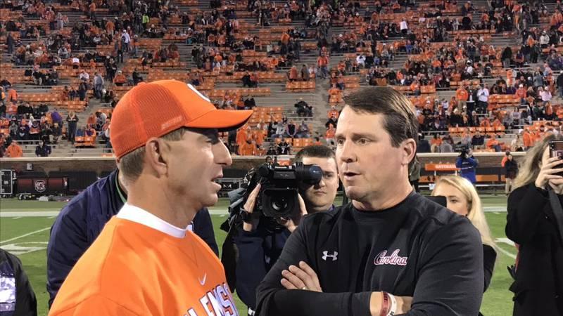Clemson head coach Dabo Swinney and USC head coach Will Muschamp talk before the 2018 Palmetto...