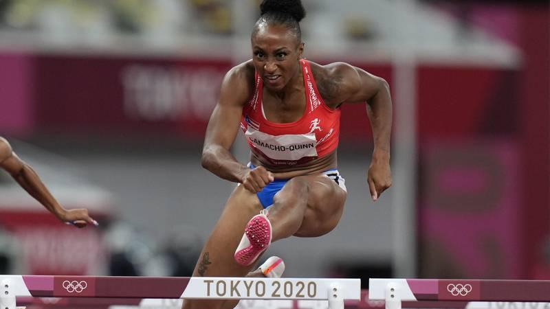 Jasmine Camacho-Quinn, of Puerto Rico, wins a women's 100-meter hurdles semifinal at the 2020...