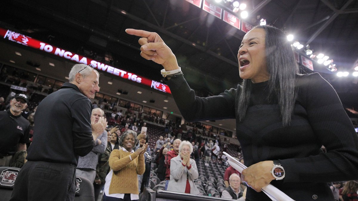 South Carolina head coach Dawn Staley points to fans while  celebrating the Gamecocks' win over...