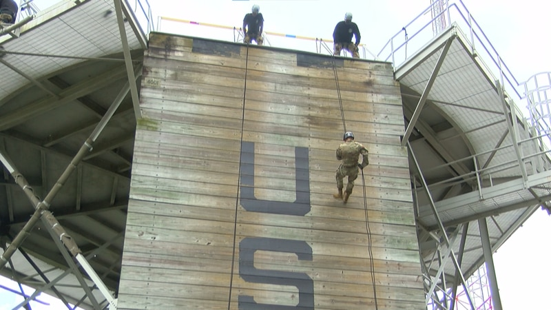 A cadet from The Citadel rappels down a 47-foot tower at Marine Corps Training Depot Parris...