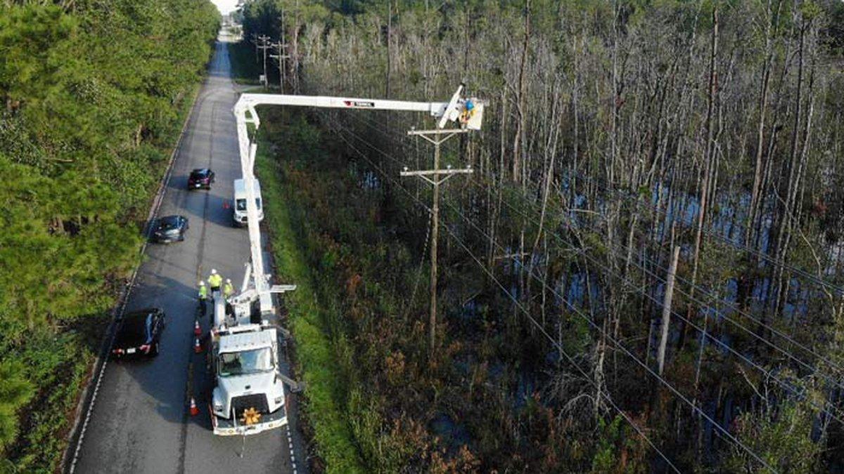 Berkeley County Electric Co-Op crews work to restore power after Hurricane Dorian.