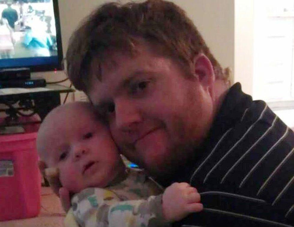 Derek Stilson with his son. (Source: Joel Vaughan)