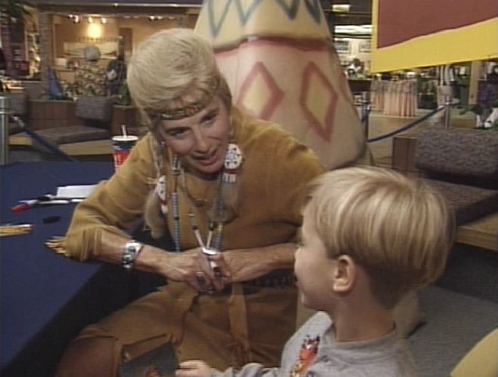 Happy Raine visits with a fan during a personal appearance. (Source: Live 5)