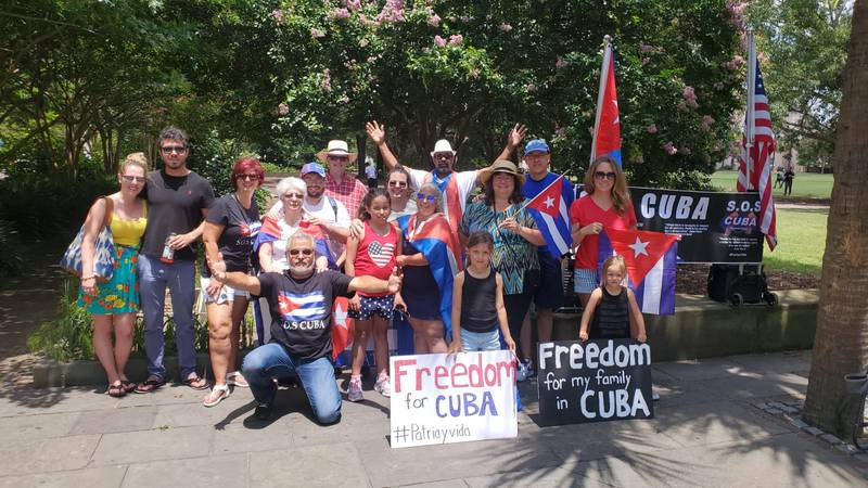 A small group gathered on Sunday afternoon in downtown Charleston to show support for Cuba.