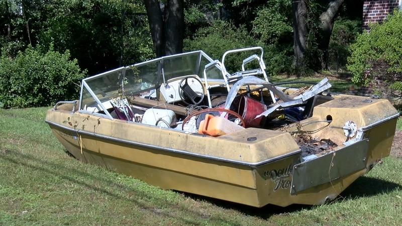 """A boat named """"Double Trouble"""" is left at a home on Otranto Road in North Charleston."""