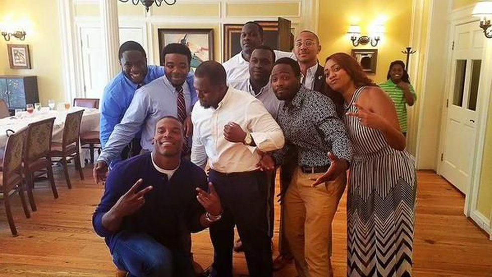 Newton with friends and family of Tywanza Sanders. (Photo: @panthec, Twitter)