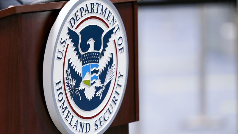 FILE - In this Nov. 20, 2020, file photo a U.S. Department of Homeland Security plaque is...