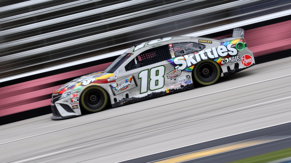 FORT WORTH, TEXAS - OCTOBER 28: Kyle Busch, driver of the #18 Skittles Zombie Toyota, drives...