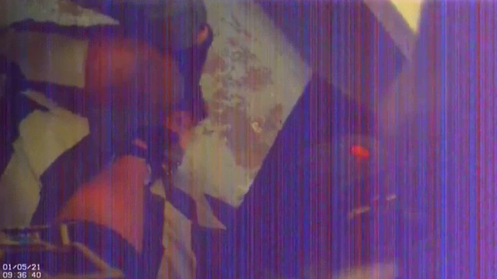 A still image from footage from a body camera worn by a deputy responding to Sutherland's cell...