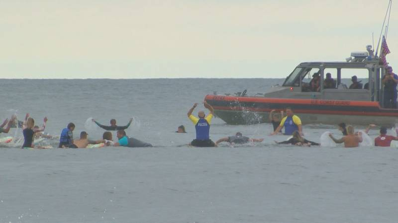 A paddle out ceremony was held in Garden City for an HCPD officer who lost his battle to...
