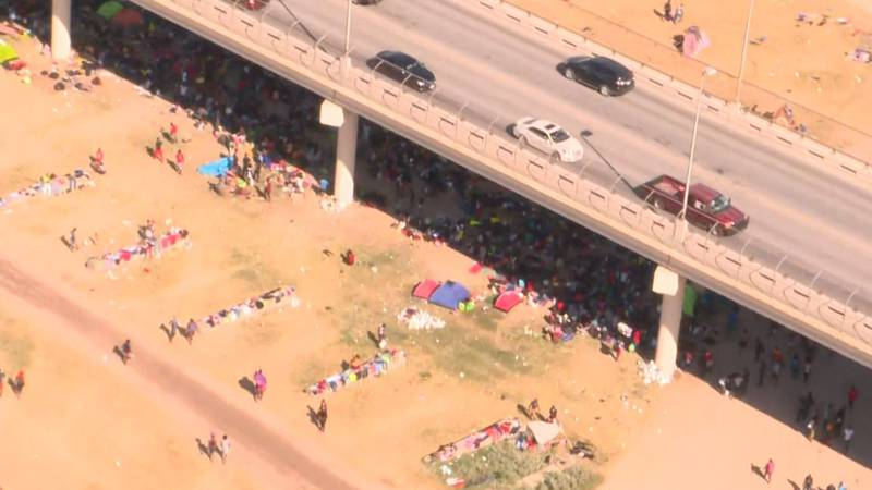 Aerial footage from Thursday, Sept. 16, 2021, shows migrants camped under the bridge in Del...