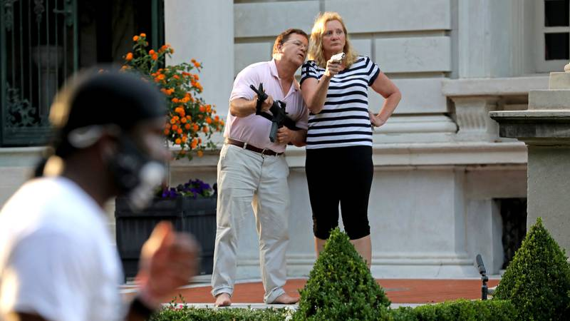 In this June 28, 2020 file photo, armed homeowners Mark and Patricia McCloskey, standing in...