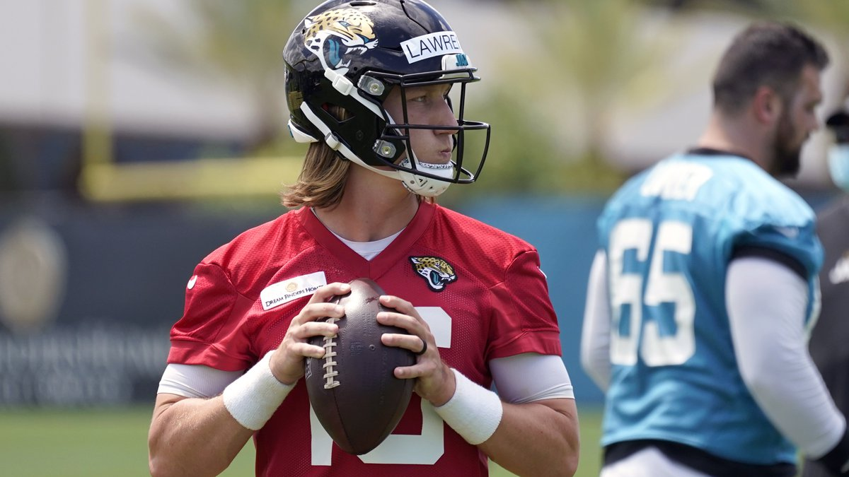 Jacksonville Jaguars quarterback Trevor Lawrence looks for a receiver during an NFL football...