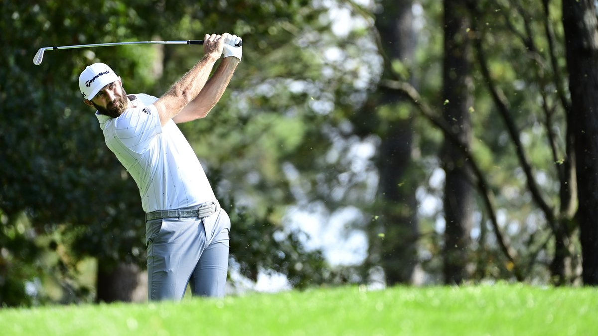 Dustin Johnson plays his stroke from the No. 4 tee during Round 3 of the Masters at Augusta...