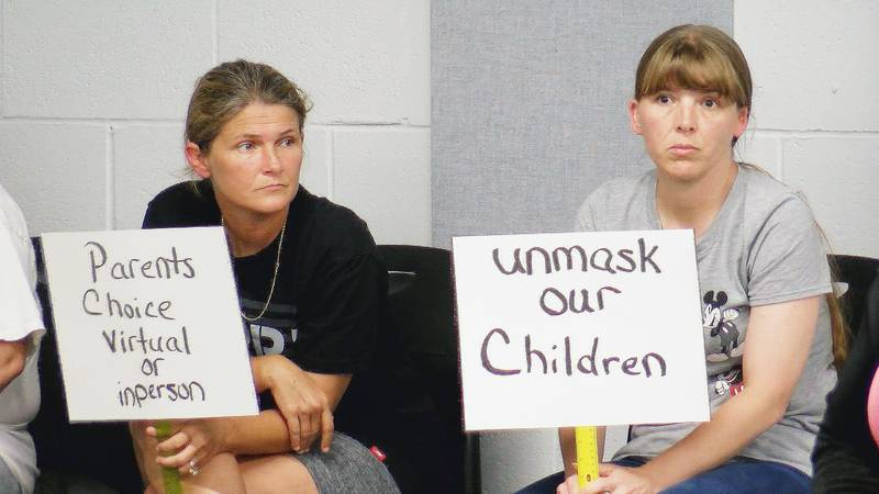 Ahead of the vote, half a dozen parents addressed the board. Some advocated for school to...