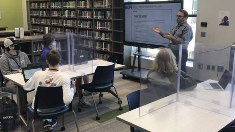 Lucy Beckham High School Personal Finance teacher Bill Joy leads a class designed to guide his...