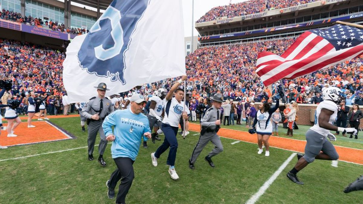 Brent Thompson takes the field along with The Citadel before their game at Clemson in 2017