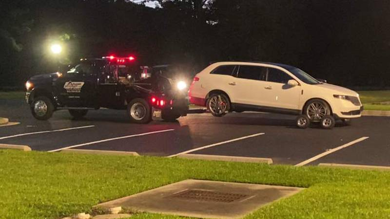 A tow truck prepares to remove a vehicle that had been reported stolen from North Charleston,...