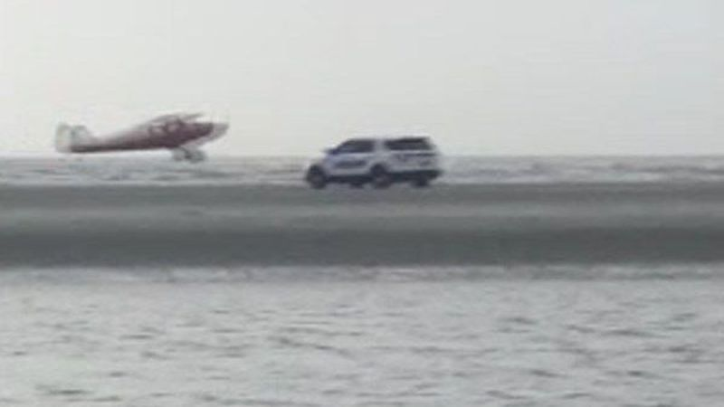 Video showed the plane taking off from Sullivan's Island as a police vehicle arrived on the...