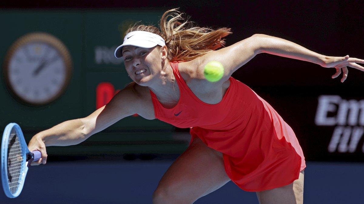 Russia's Maria Sharapova makes a forehand return to Croatia's Donna Vekic during their first...