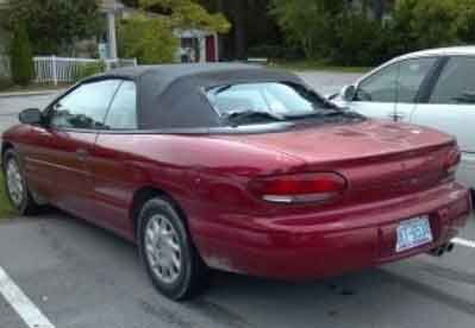 SLED is searching for a red 1998 Chrysler Sebring with a black top with NC tags AKT 6534.