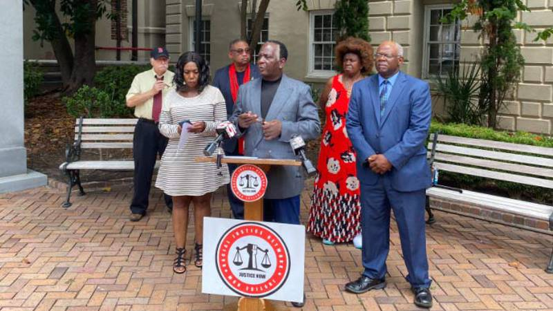 Racial Justice Network President Elder James Johnson (center) is calling for Ninth Circuit...