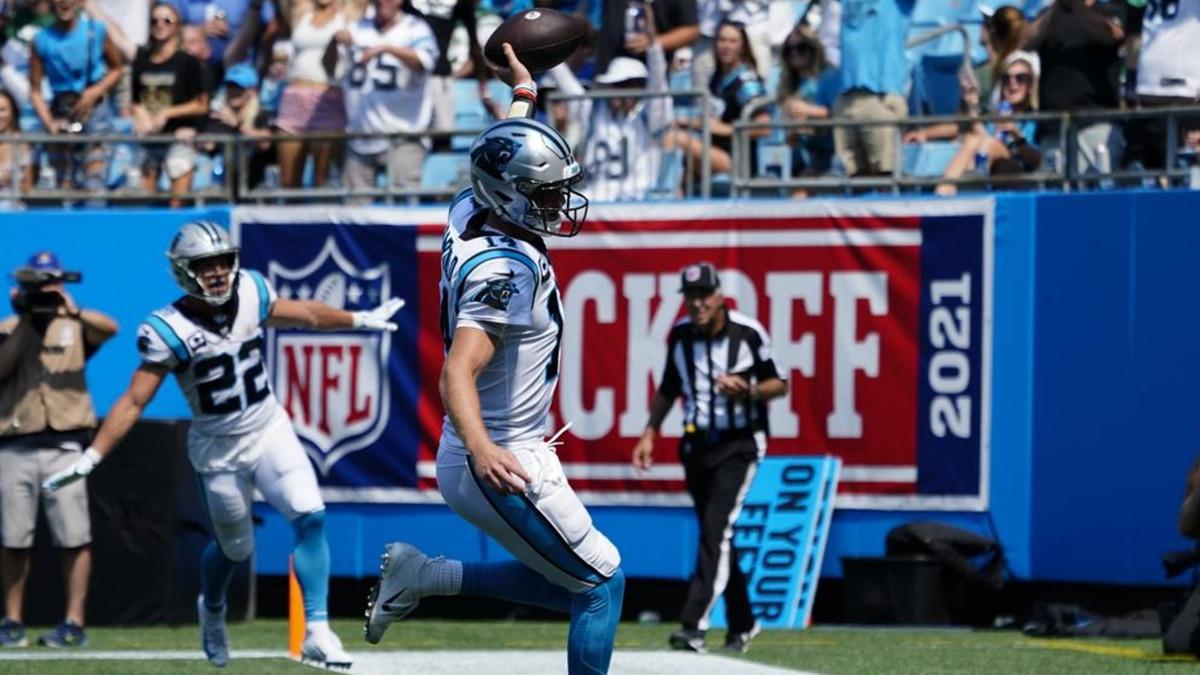 Carolina Panthers quarterback Sam Darnold celebrates after scoring against the New York Jets...