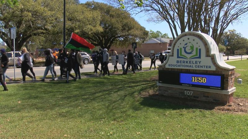 Students march to the high school in Moncks Corner to voice concerns about racial inequalities.
