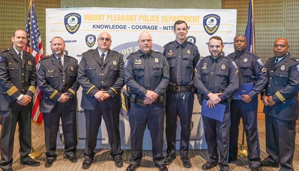 Mount Pleasant Police Chief Mark Arnold, far left, promoted several other officers as part of...