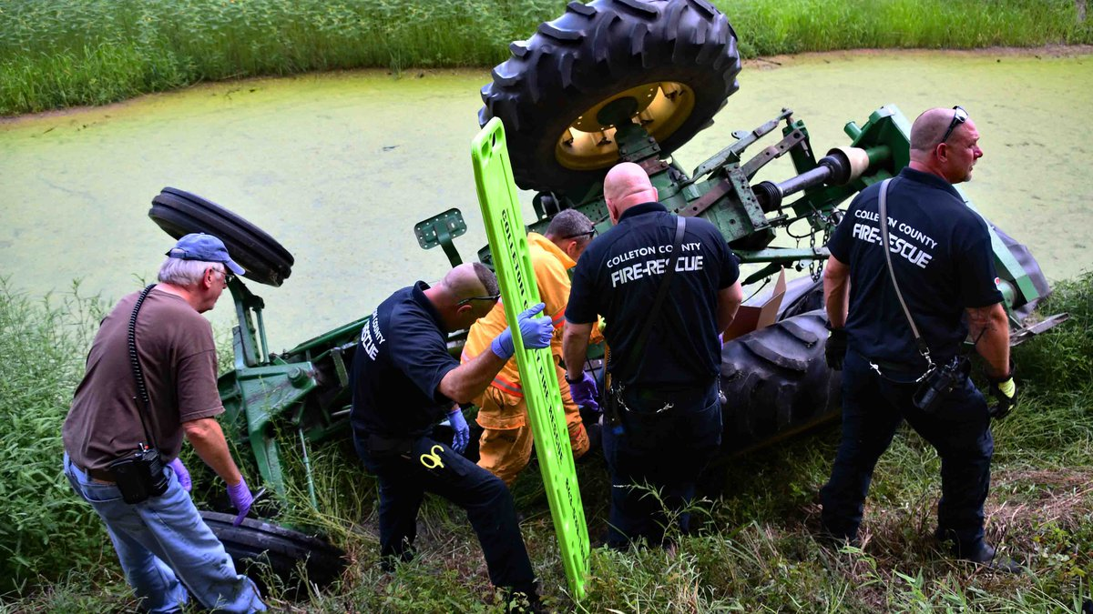 First responders say the man was trapped under his tractor after the piece of equipment rolled...