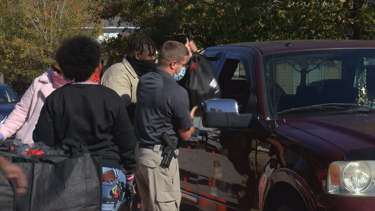 Volunteers gave out turkeys, sides and hot meals drive-through style at the Community Resource...