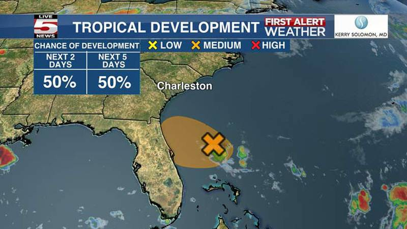 The National Hurricane Center reduced the chance of tropical development for a system of storms...