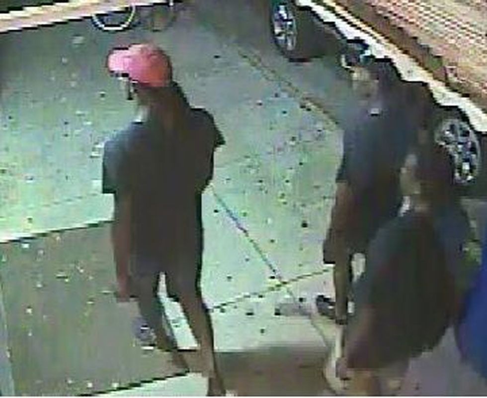 Surveillance pictures of the suspects taken near the robbery.