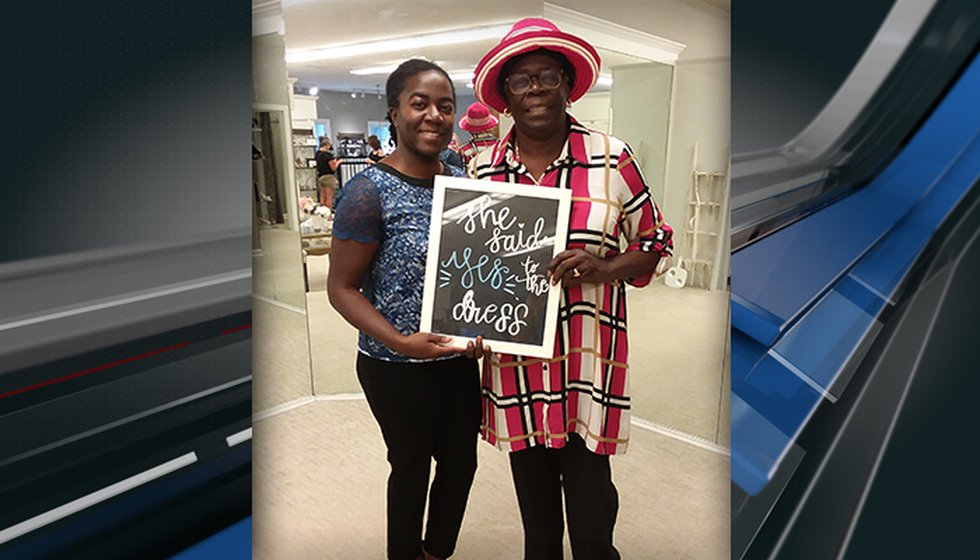 Treasure White and her mom celebrate after finding a wedding dress for White at Jean's Bridal...