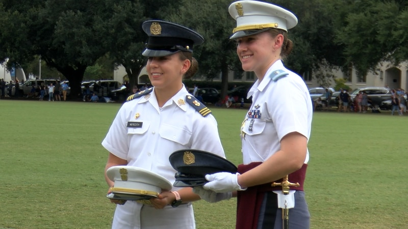 Cadet Col. Kathryn Christmas and Cadet First Captain Kasey Meredith exchange hats at the...
