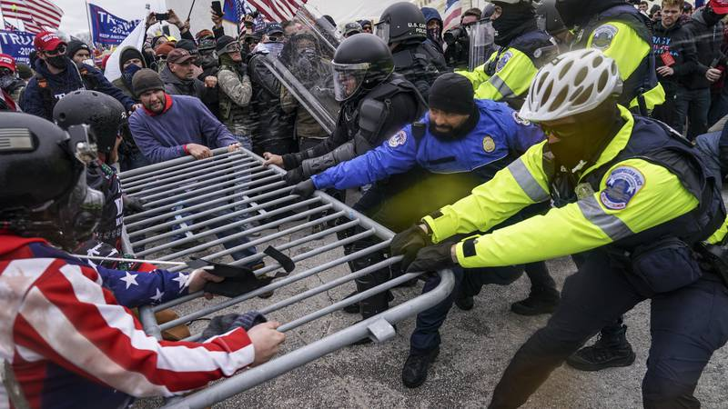 FILE - In this Jan. 6, 2021 file photo, violent insurrectionists loyal to then-President Donald...