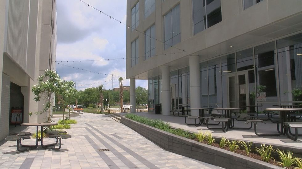 A new parking garage (left) next to the Charleston Tech Center has 816 parking spaces for both...