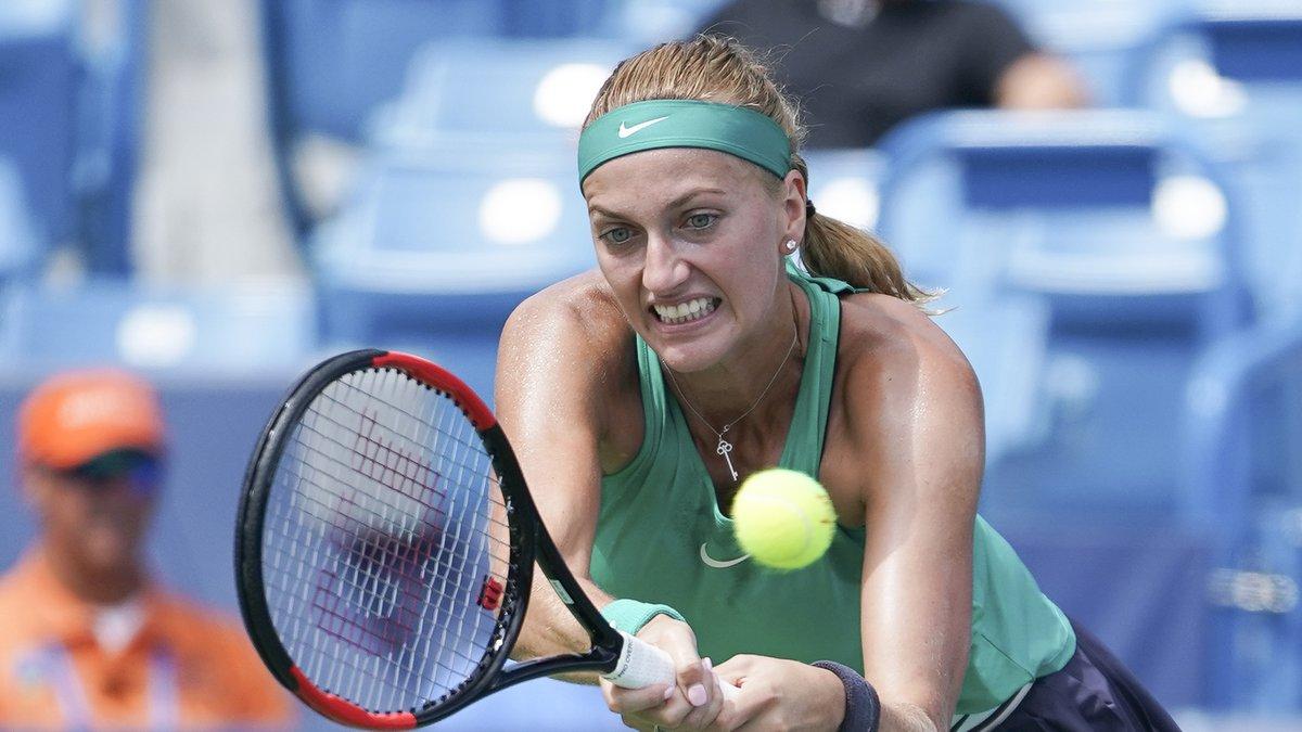 Petra Kvitova, of the Czech Republic, returns to Kiki Bertens, of the Netherlands, in a...