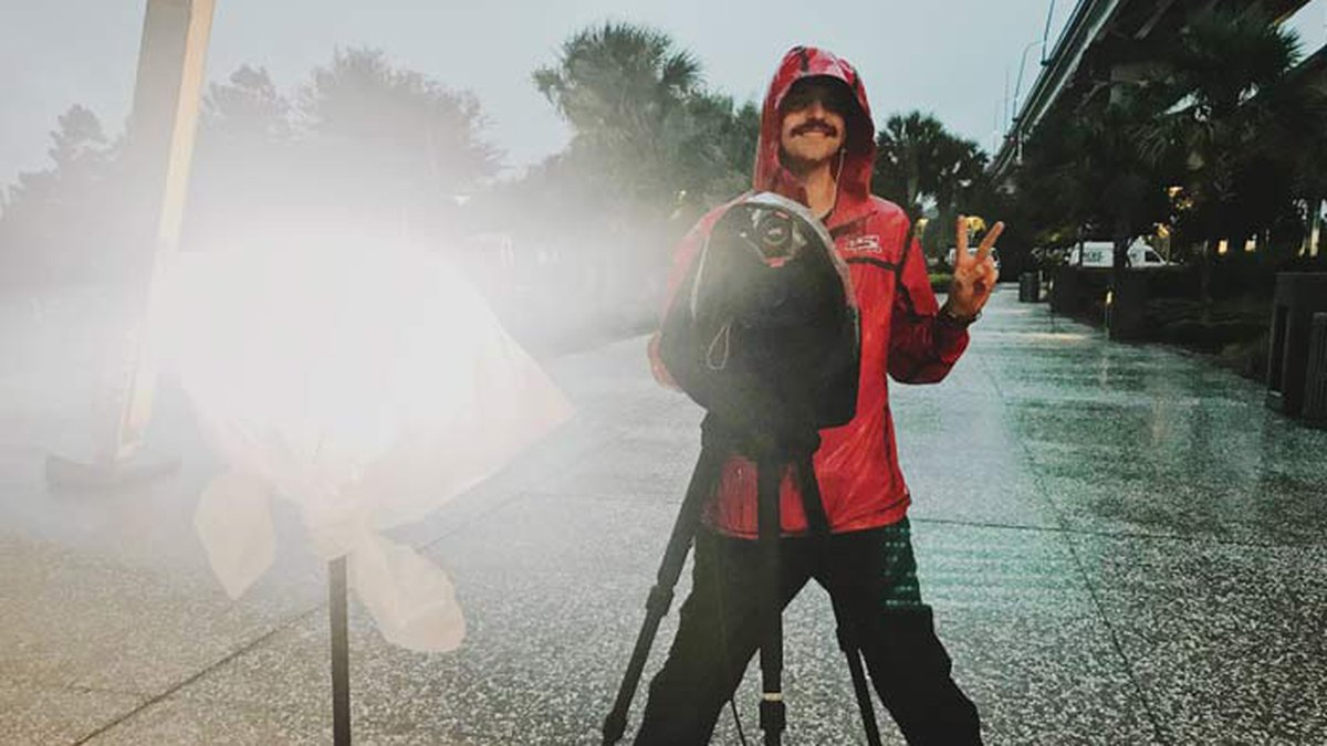 Live 5 Photojournalist Jackson Helms, seen here covering Hurricane Dorian, steps in front of...