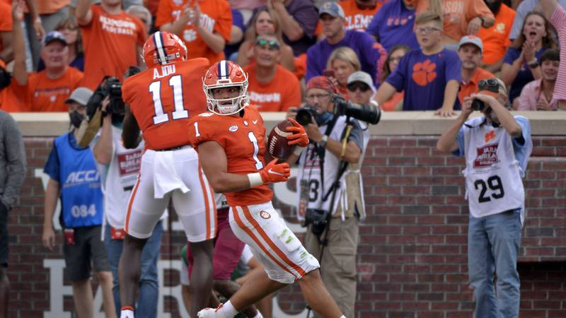 Clemson running back Will Shipley (1) scores a touchdown in the first half of an NCAA college...