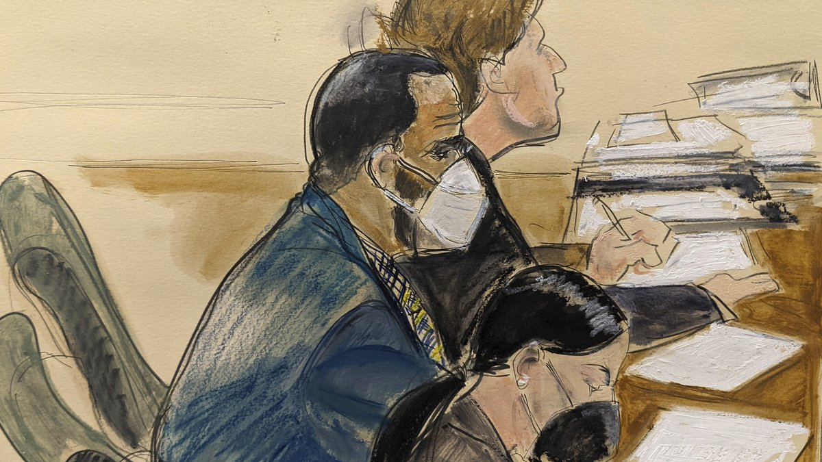 In this courtroom artist's sketch R. Kelly, left, listens during his trial in New York,...