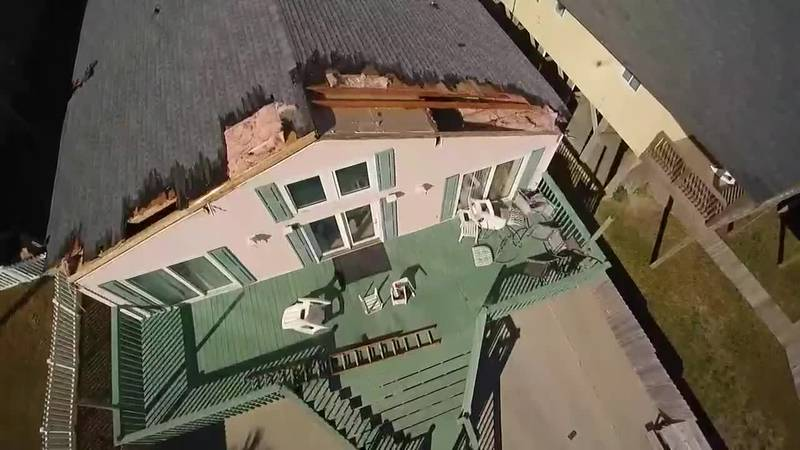 Strong winds rip off parts of a roof at a North Myrtle Beach home.