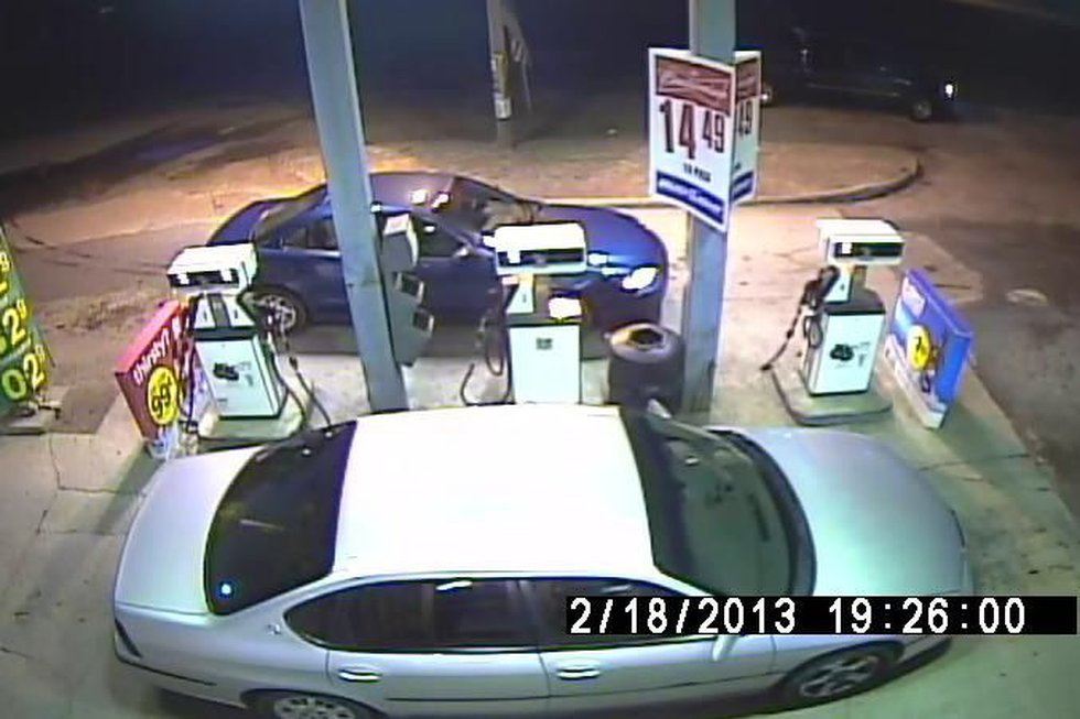 Authorities say the light colored Impala closest to camera is a vehicle of interest. (SCHP)