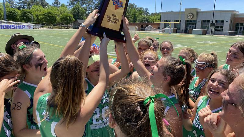 The Lady Bishops of Bishop England hoist the SCHSL 4A state championship for a fifth...