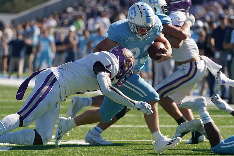 Carlos Davis passed for a career-high 401 yards and three touchdowns, TJ Jones ran for 132 and...