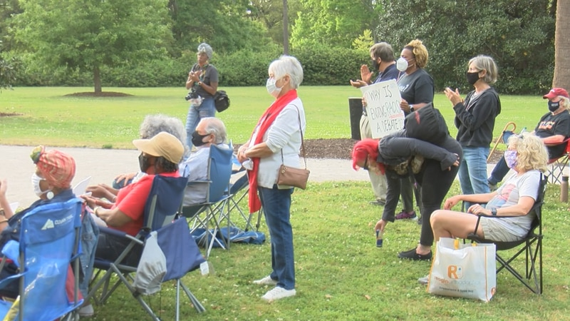 Sunday evening, dozens showed up in Charleston for a rally and vigil amid numerous recent mass...