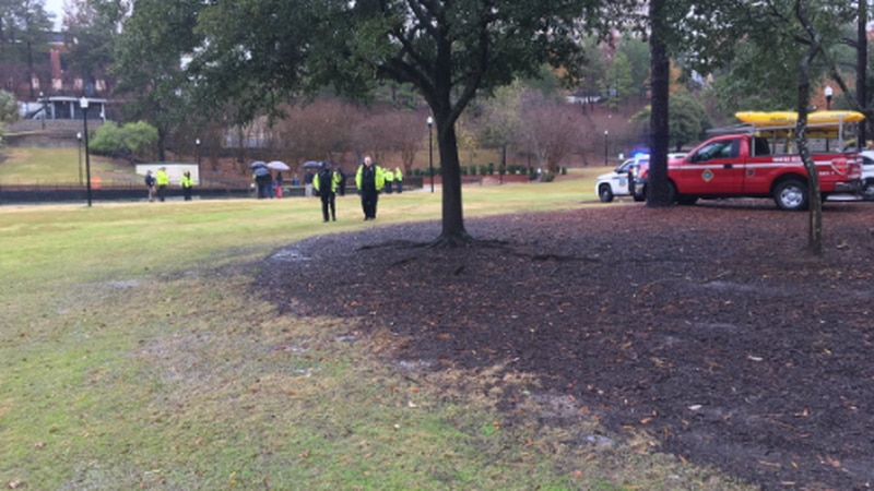 Officials are on the scene at Finlay Park where a body was found Friday.